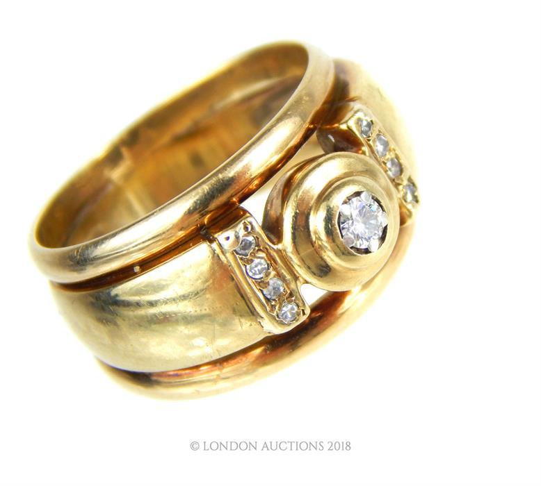 Lot 9 - A 9 ct yellow gold, chunky, brilliant cut diamond ring