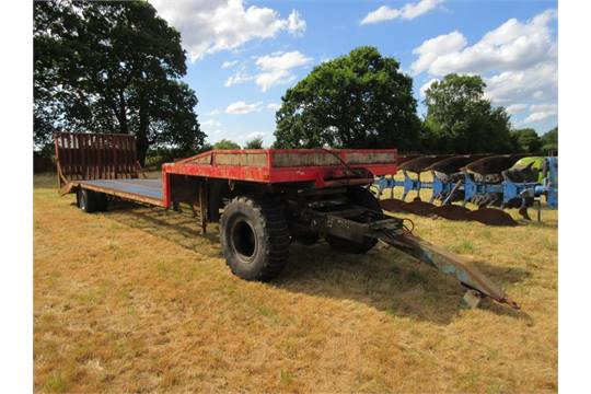 Taskers single axle, step frame, beaver tail low loader trailer