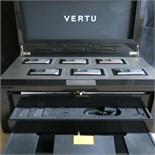 Lot 7 - Presentation Display Case of 6 Vertu Ascent Racetrack Legend Series Phones. Collectors Edition 11/