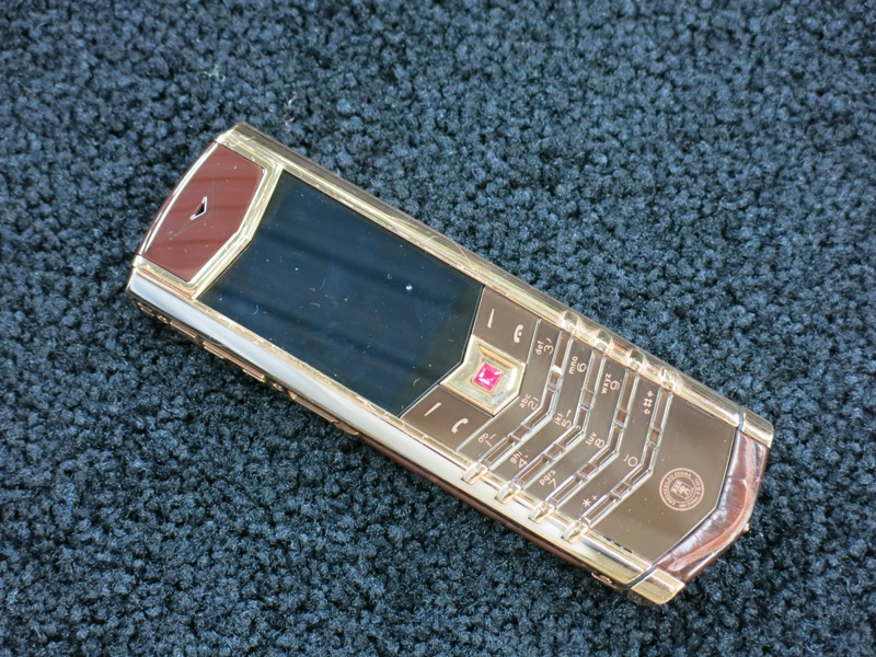 Lot 18 - Vertu 18kt Red Gold Signature S Phone with Ruby Select Key. Furnished with Ceramic Pillow,