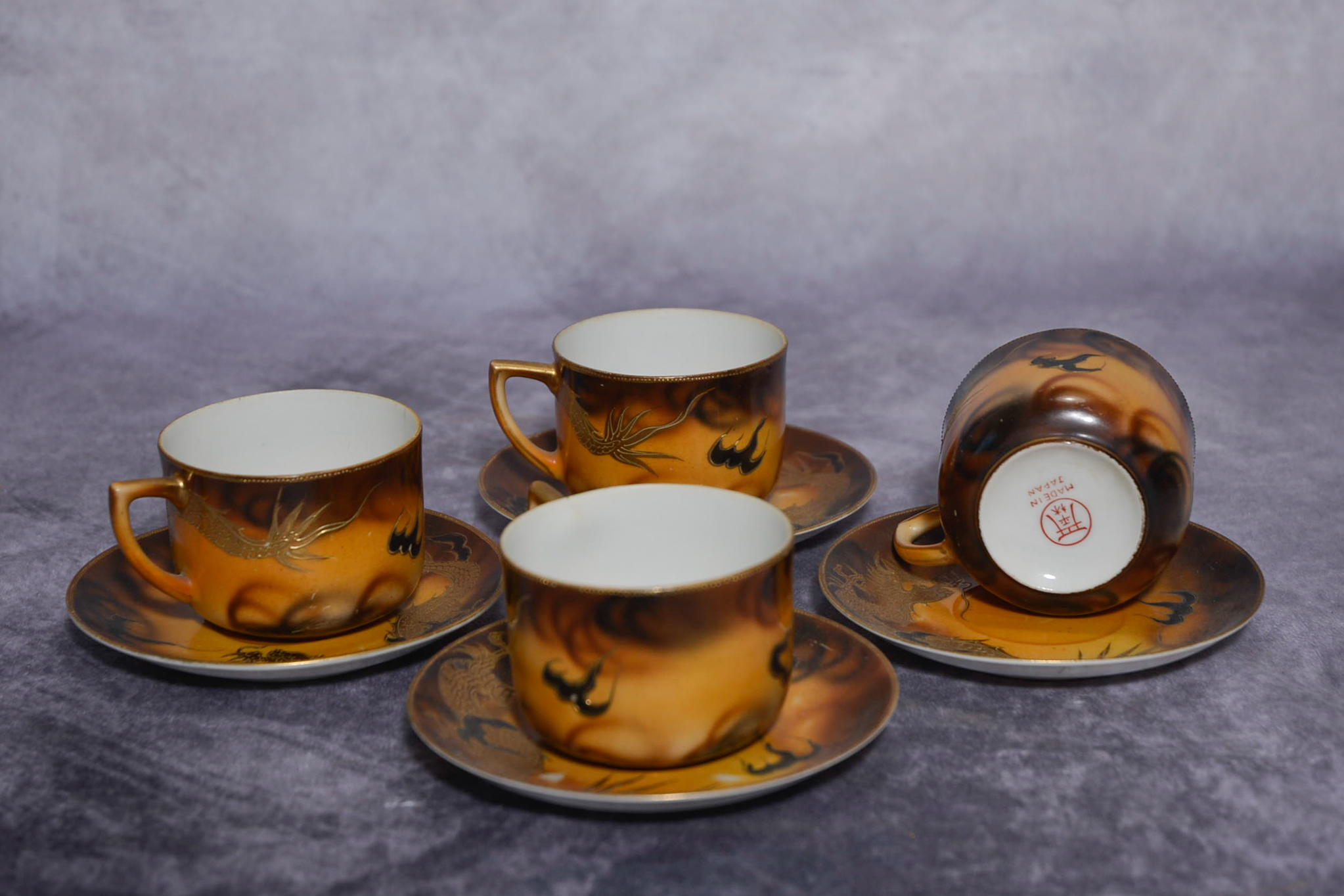 Set of four Japanese cups and saucers