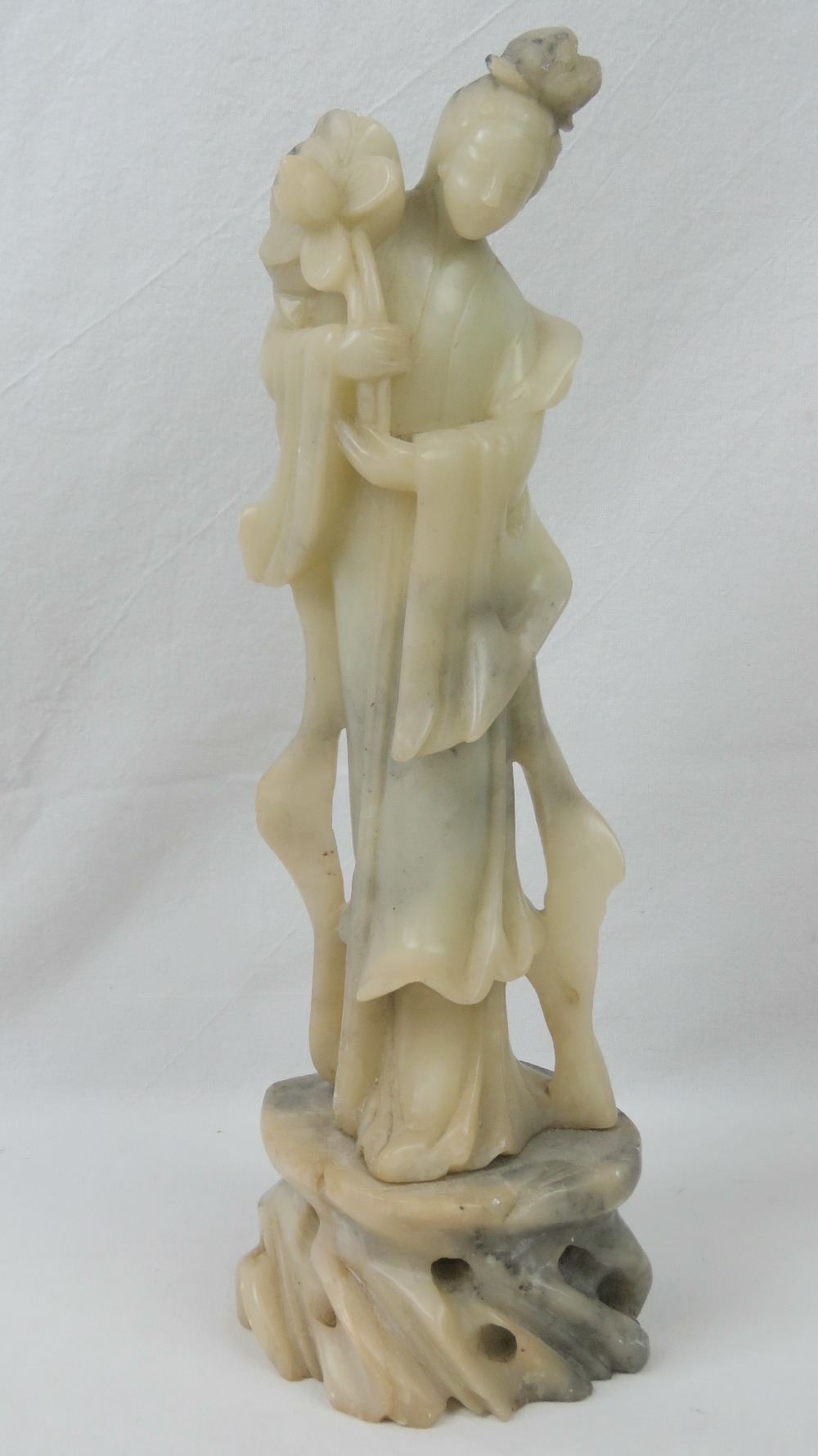 Lot 630 - A single soapstone figuring of a standin