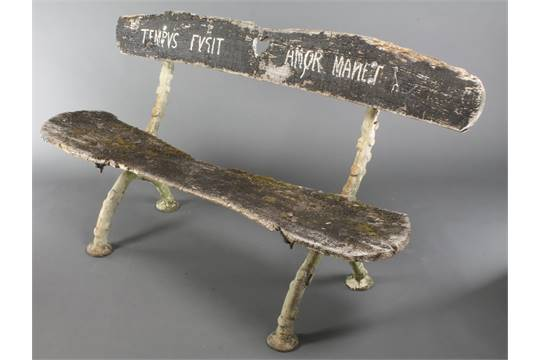 An Antique Rustic Cast Iron Garden Bench, The Frame In The Form Of Tree  Roots, With Wooden Plank