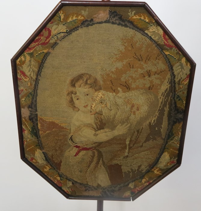 Lot 30 - A 19th century mahogany pole screen, the octagonal screen decorated with a tapestry panel of a