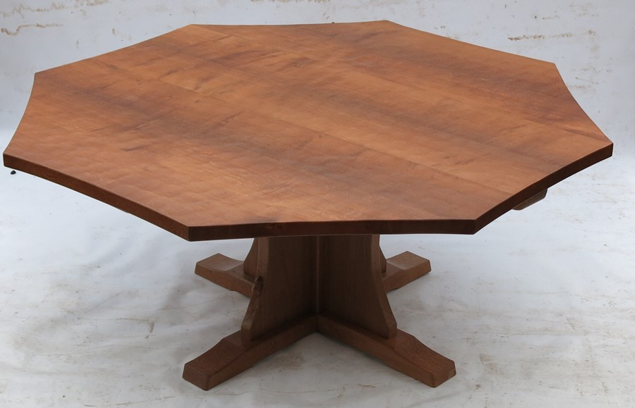 Lot 59 - Robert Thompson Mouseman, an oak octagonal dining table, raised on a cross base, with adzed