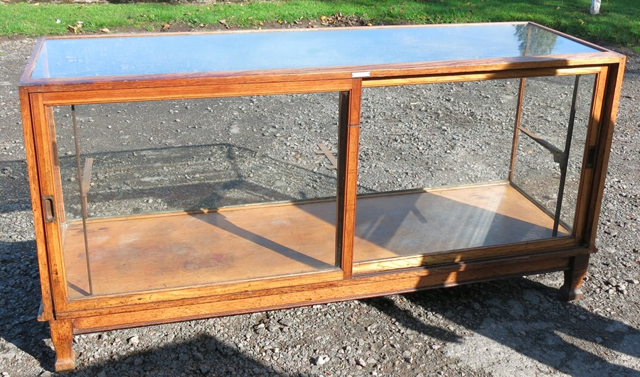 An oak and glass shop play counter, with sliding doors and shelves, 70ins x 23ins x 35.5ins - Image 2 of 3