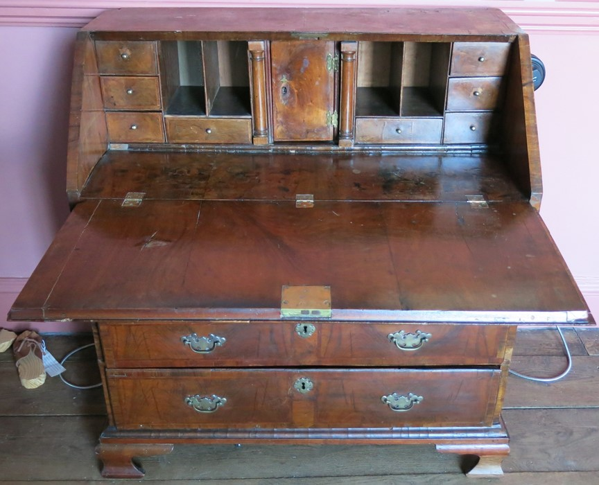 An 18th century walnut bureau, fitted with a curvetto drawer below the fall flap, over two short and - Image 2 of 4
