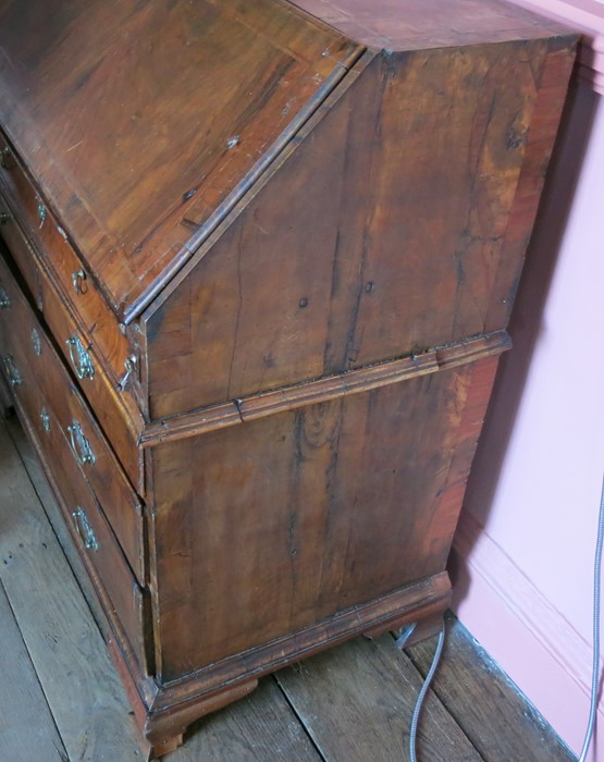 An 18th century walnut bureau, fitted with a curvetto drawer below the fall flap, over two short and - Image 3 of 4