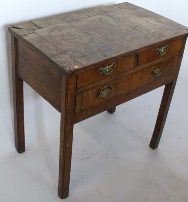 Lot 25 - A 19th century mahogany low boy, fitted with two short over one long drawer, raised on square