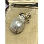 CARVED BAROQUE PEARL PENDANT/BROOCH IN GOLD SET WITH SAPPHIRES & DIAMONDS