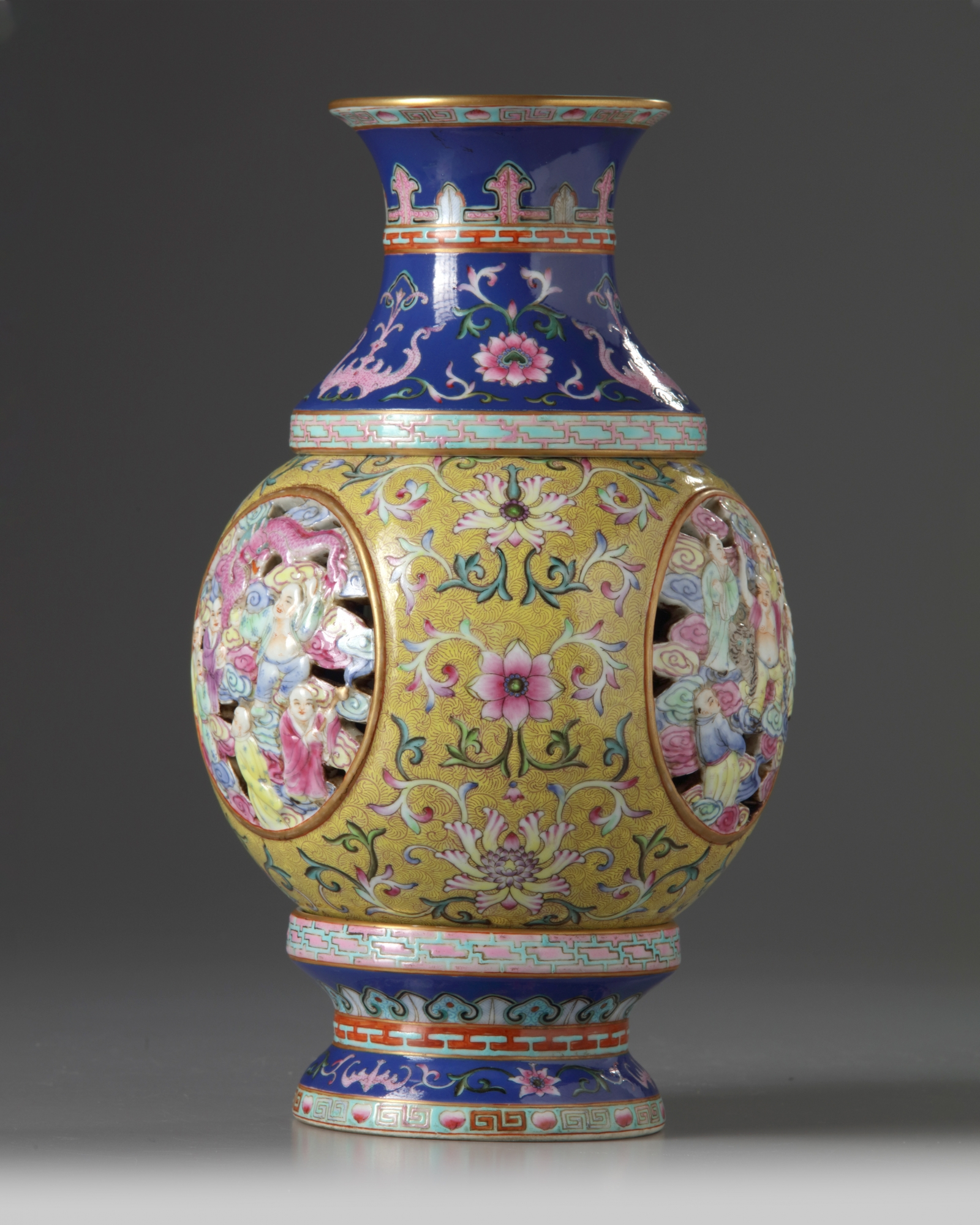 Lot 41 - A Chinese famille rose 'Eighteen Luohan' revolving vase