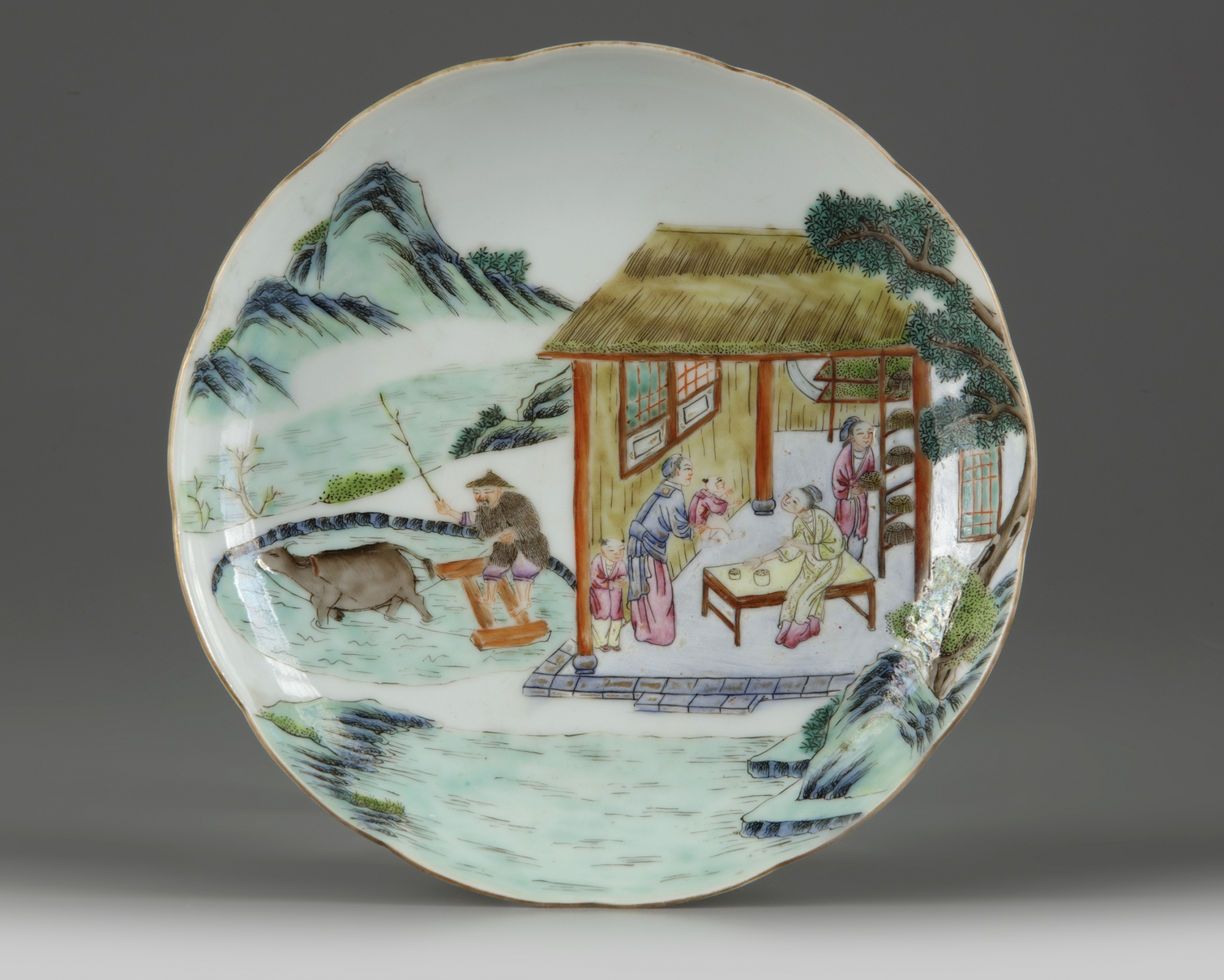 Lot 44 - A Chinese famille rose 'tilling' dish