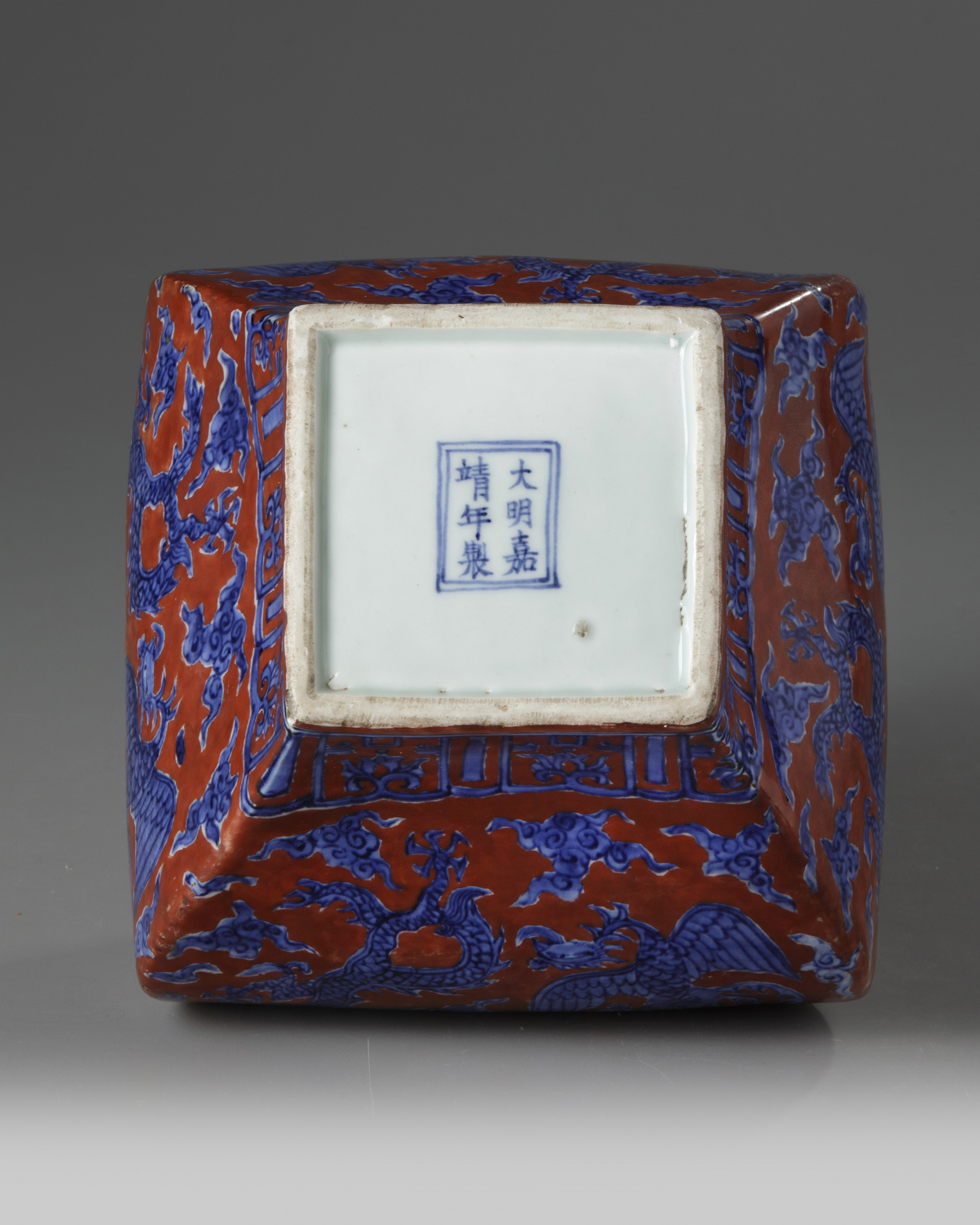 Lot 11 - A Chinese iron-red-ground 'dragon and phoenix' square-section jar