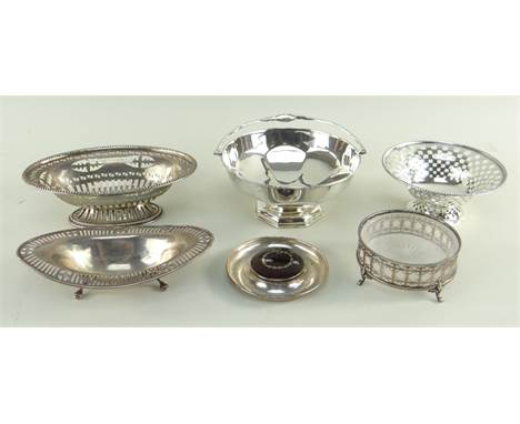 SIX EARLY 20TH CENTURY SILVER BONBON DISHES, comprising two footed oval and one circular, with pierced sides, one with swing
