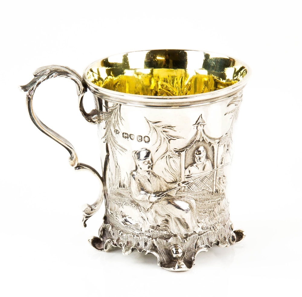 Lot 2020 - Victorian silver christening mug, embossed and moulded with an Oriental scene, on four shaped