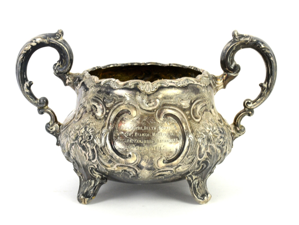 Lot 2008 - Victorian silver three-piece tea service, elaborately chased and with inscriptions, teapot with
