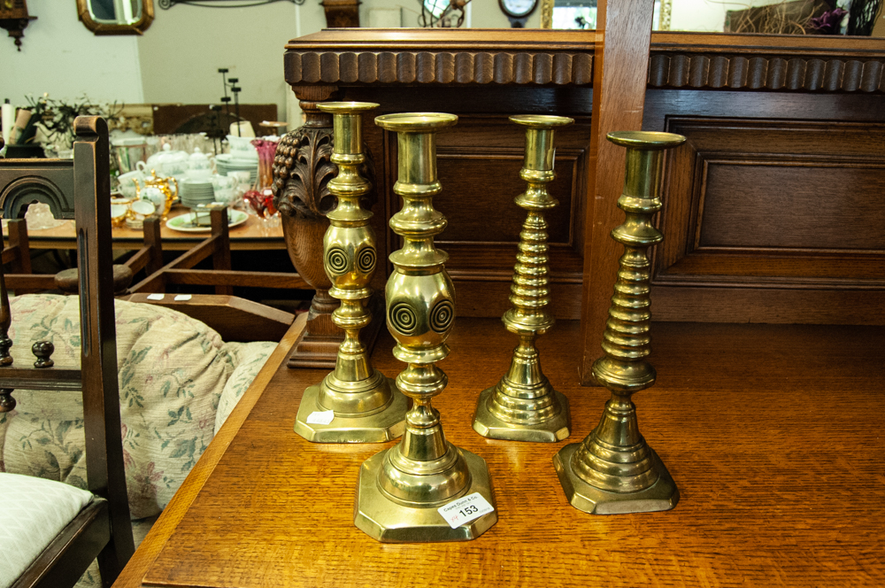 Lot 153 - TWO PAIRS OF LARGE BRASS CANDLESTICKS