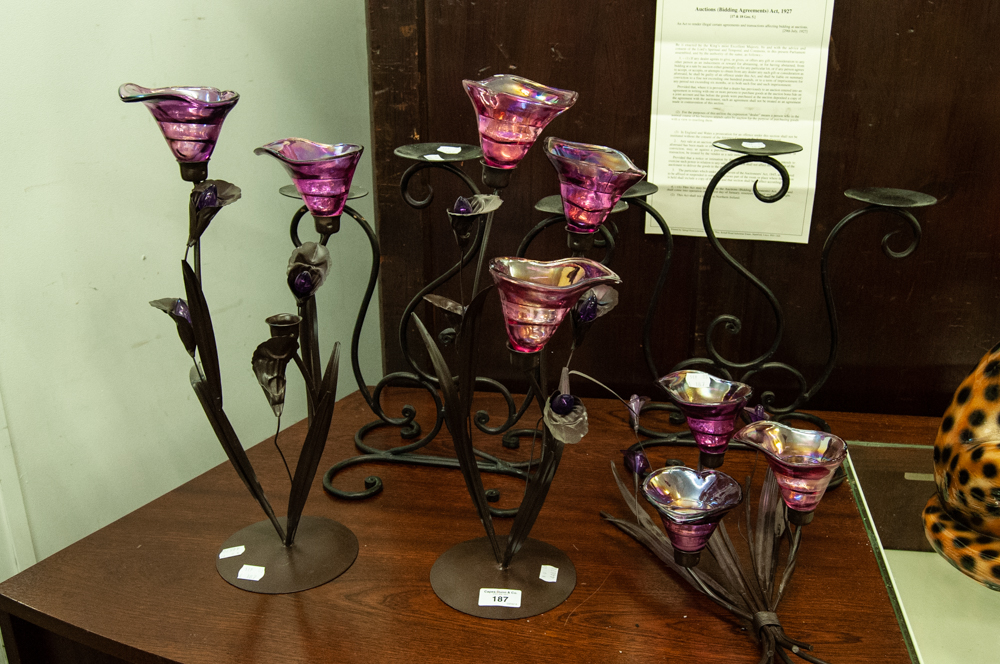 Lot 187 - PAIR OF BLACK WROUGHT IRON PLANT FORM THREE LIGHT CANDELABRA WITH PURPLE GLASS SCONCES AND THE