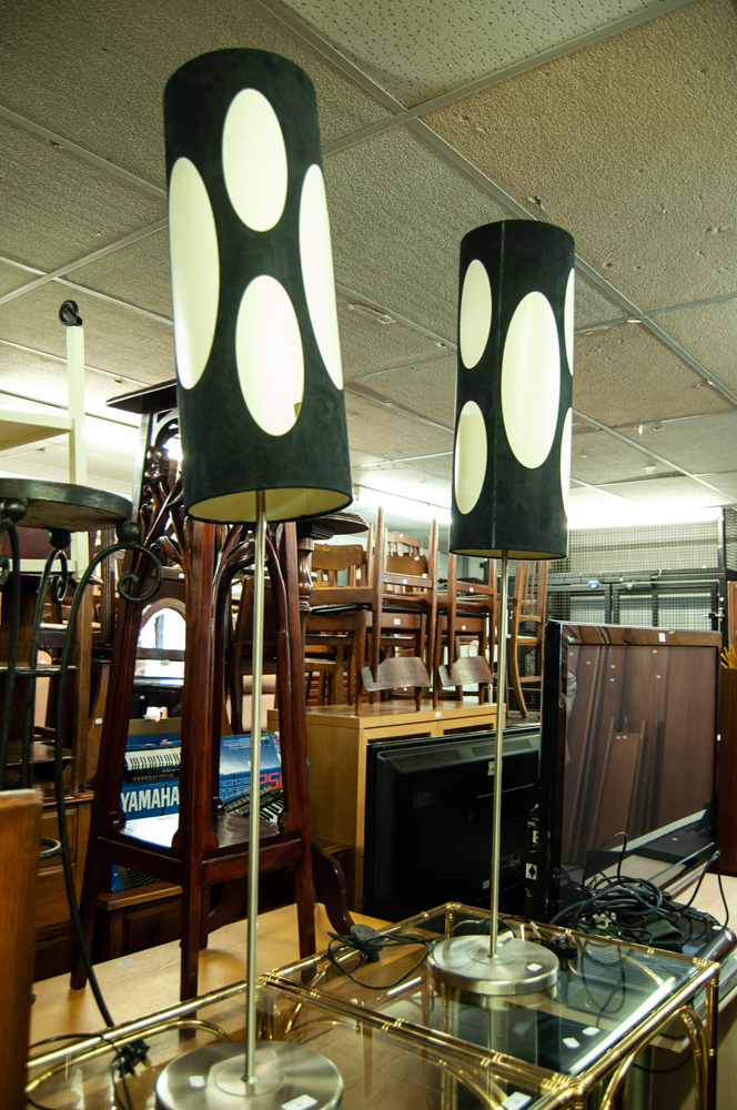 Lot 91 - PAIR OF MODERN STAINLESS STEEL FLOOR LAMPS EACH WITH CIRCULAR BASE, WITH LONG CYLINDRICAL SHADE (