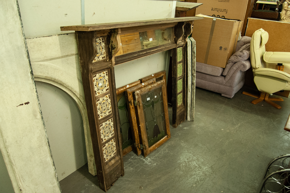 "Lot 135 - LATE VICTORIAN WOODEN CERAMIC TILE INSET FIRE SURROUND WITH MIRROR BENEATH MANTEL SHELF, 47"" (119."