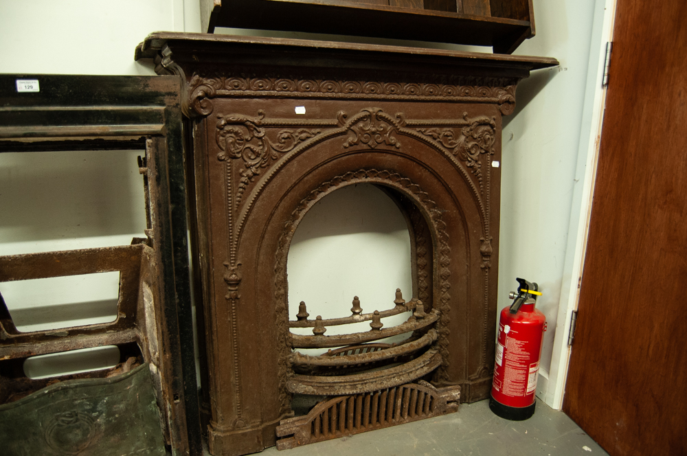 PAIR OF VICTORIAN DECORATIVE CAST IRON BEDROOM FIRE SURROUNDS WITH ARCHED RECESSES AND GRATES IN