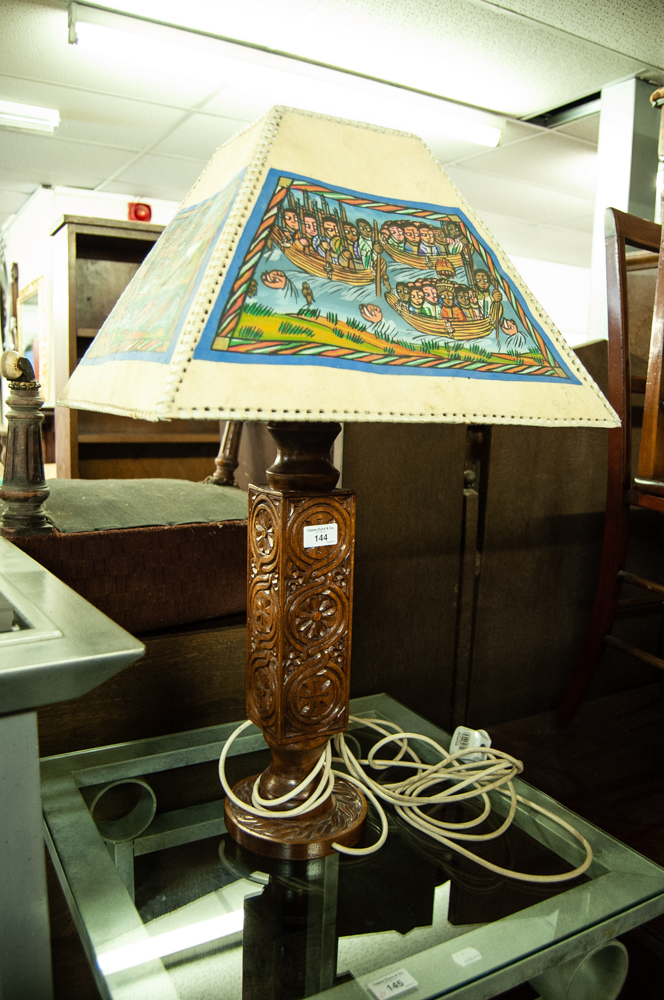 Lot 144 - LARGE CARVED WOOD TABLE LAMP WITH DECORATIVE SHADE
