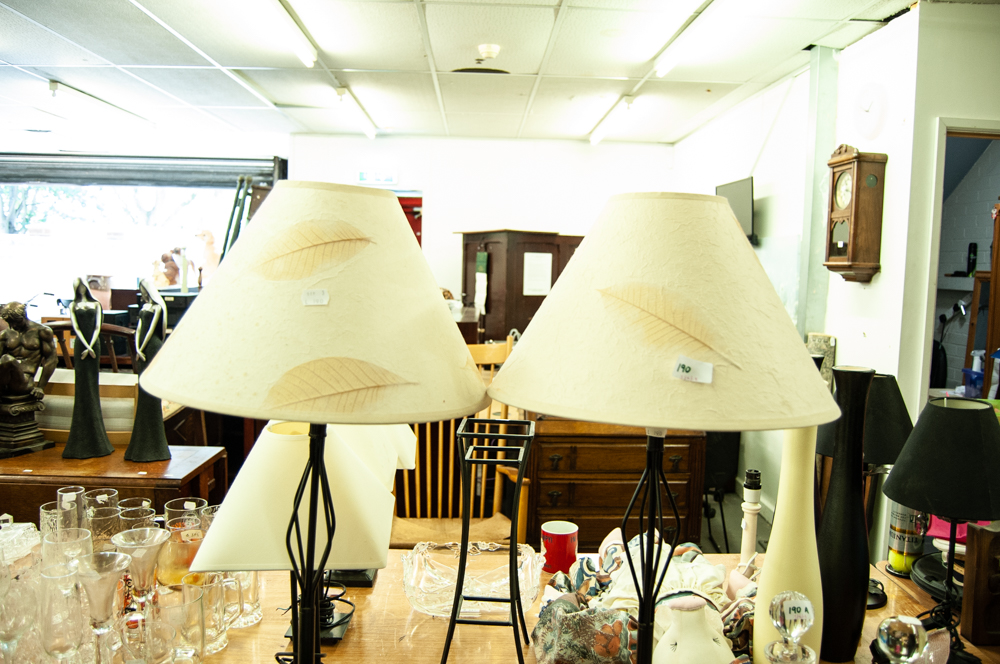 Lot 190 - PAIR OF MODERN BLACK METAL TALL SLENDER TABLE LAMPS WITH CREAM FABRIC SHADES AND A GERMAN QUARTZ