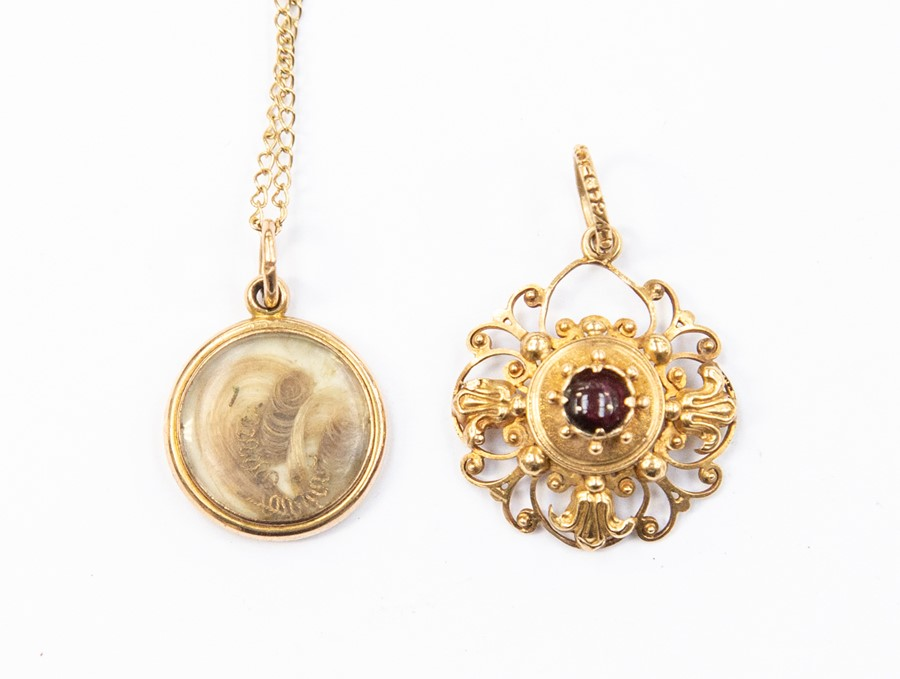 Lot 320 - A 19th century circular mourning pendant, unmarked assessed as approx 15ct, on a later 9ct gold