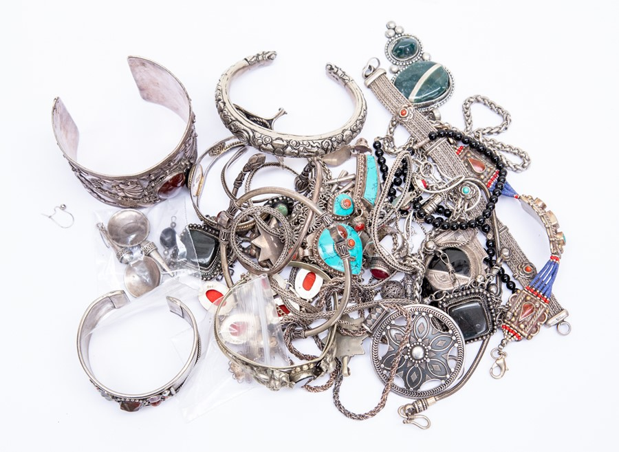 A collection of ethnic style white metal jewellery to include stone items such as turquoise type