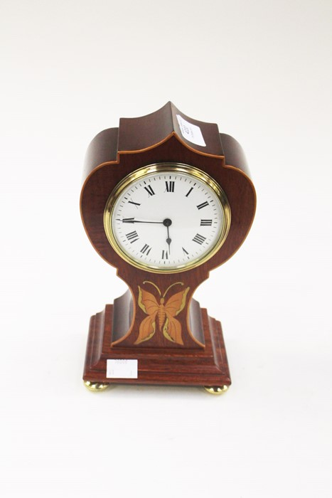 Lot 4030 - An Edwardian style inlaid mahogany mantle clock, white enamel dial and Roman numerals, on brass
