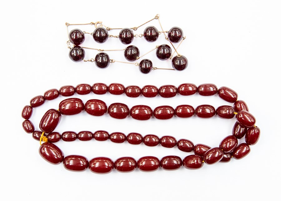A cherry amber graduated oval bead necklace, largest bead approx 24mm x 15mm, smallest approx 12mm x