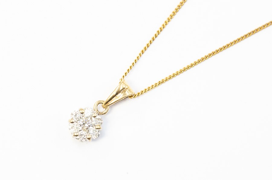 Lot 295 - A 9ct gold and diamond cluster pendant, diamond weight approx. as per stamp 0.50, on a yellow