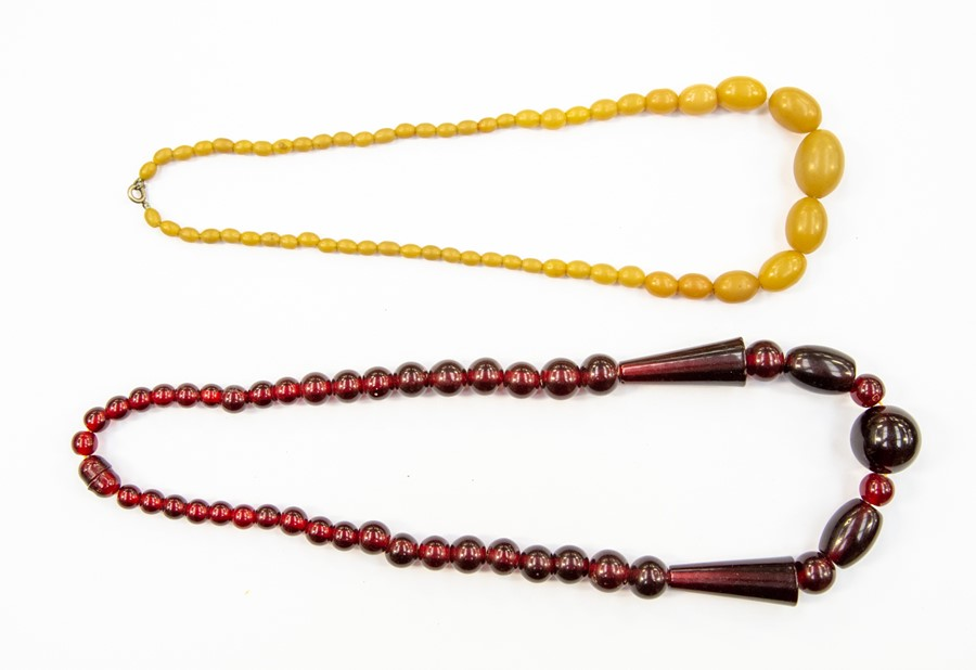 Lot 355 - A vintage cherry coloured bead necklace, with graduated round and cone shaped beads, possibly