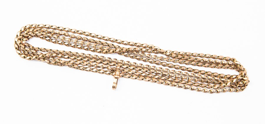 Lot 292 - **REOFFER IN A&C NOV £300-£350** A 9ct gold Guard chain chain, faceted rose gold links with swivel