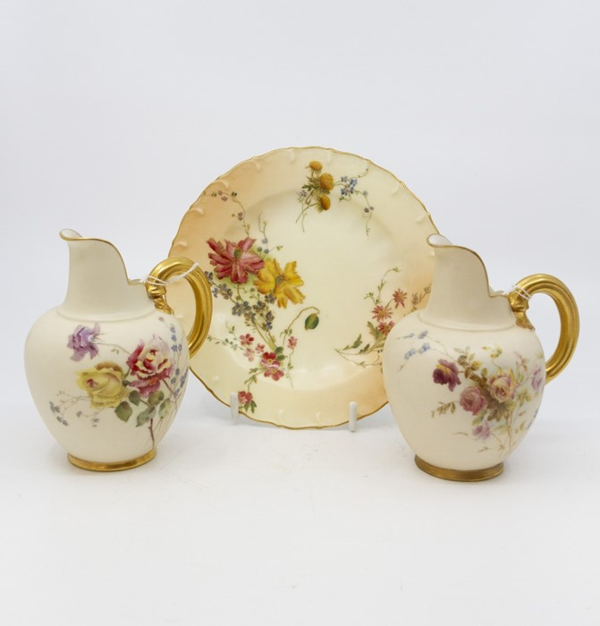 Lot 1011 - Two Royal Worcester blush ivory hand painted flat back jugs, late Victorian, RD number 29115,