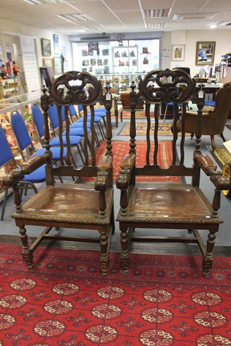 Lot 4163 - A pair of 19th century Gothic Revival oak carved halls, leather inlay arm rest and seating area,