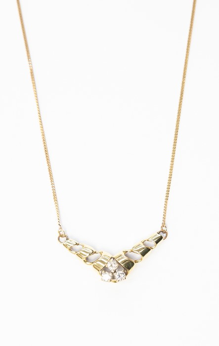Lot 297 - A diamond and 9ct gold pendant, the twisted shaped set with three claw set diamonds, to fine link