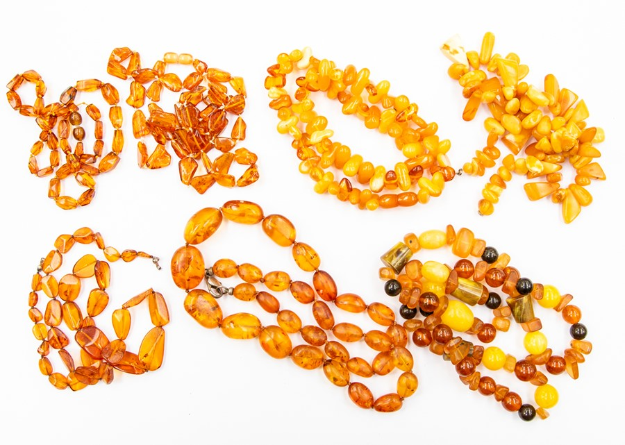 Lot 352 - A collection of various amber bead necklaces, comprising butterscotch and clear versions, graduated,