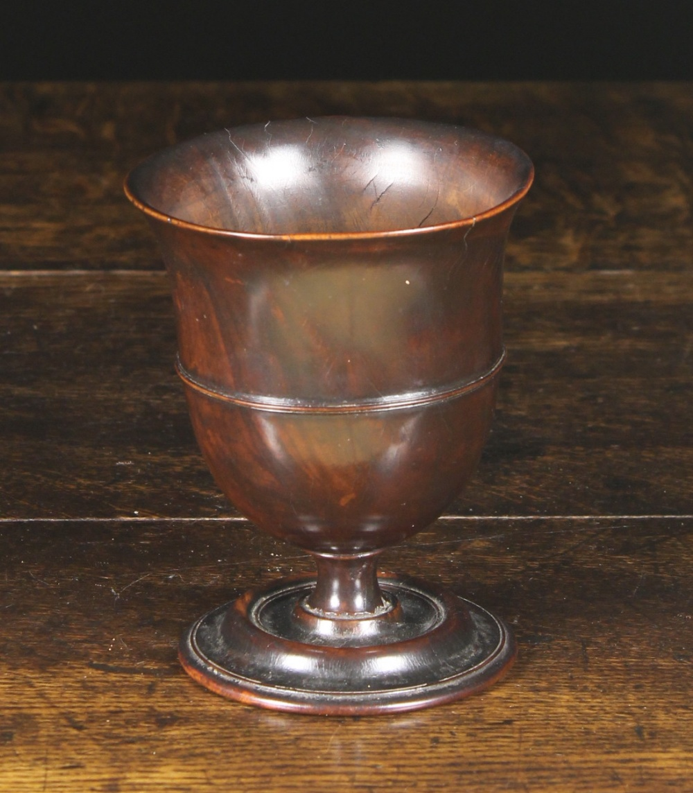 Lot 37 - An Early 18th Century English Turned Lignum Vitae Treen Goblet.