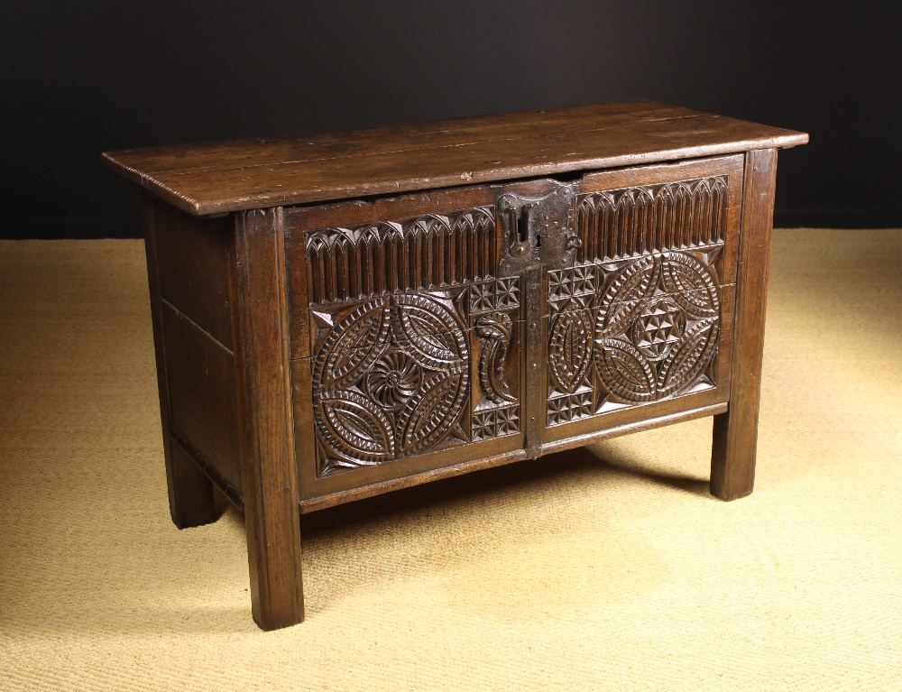 Lot 19 - A Large 16th Century Oak Coffer enriched with chip carving.