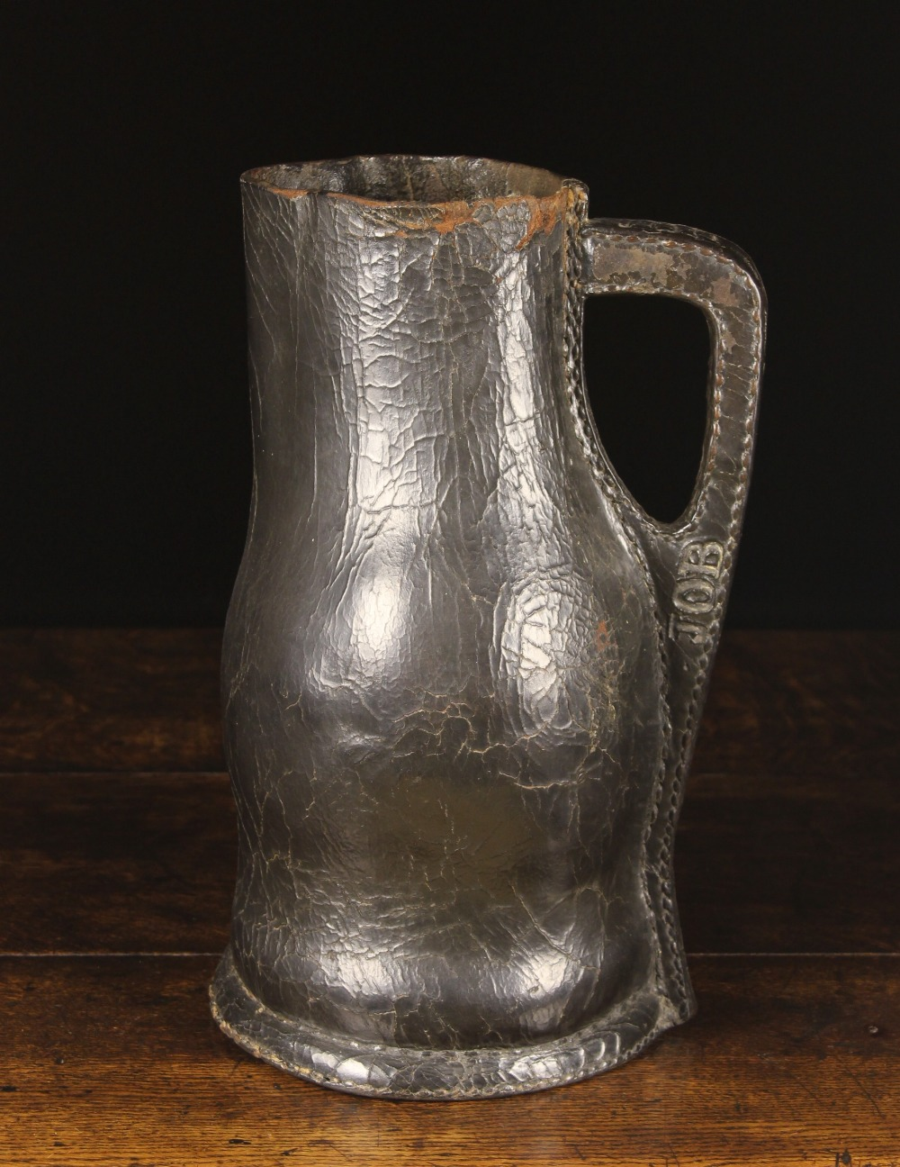 Lot 6 - A Large 17th Century Leather bombard stamped 'JOB' along the stitched handle seam,