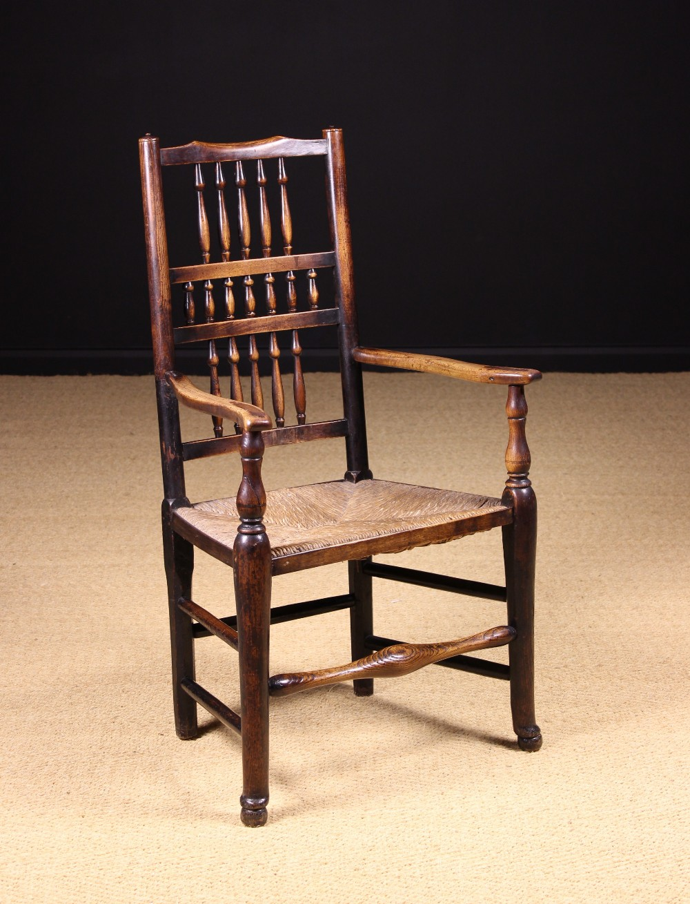 Lot 46 - An Ash Spindle-backed Rush-seat Armchair attributed to North West England, Circa 1800.