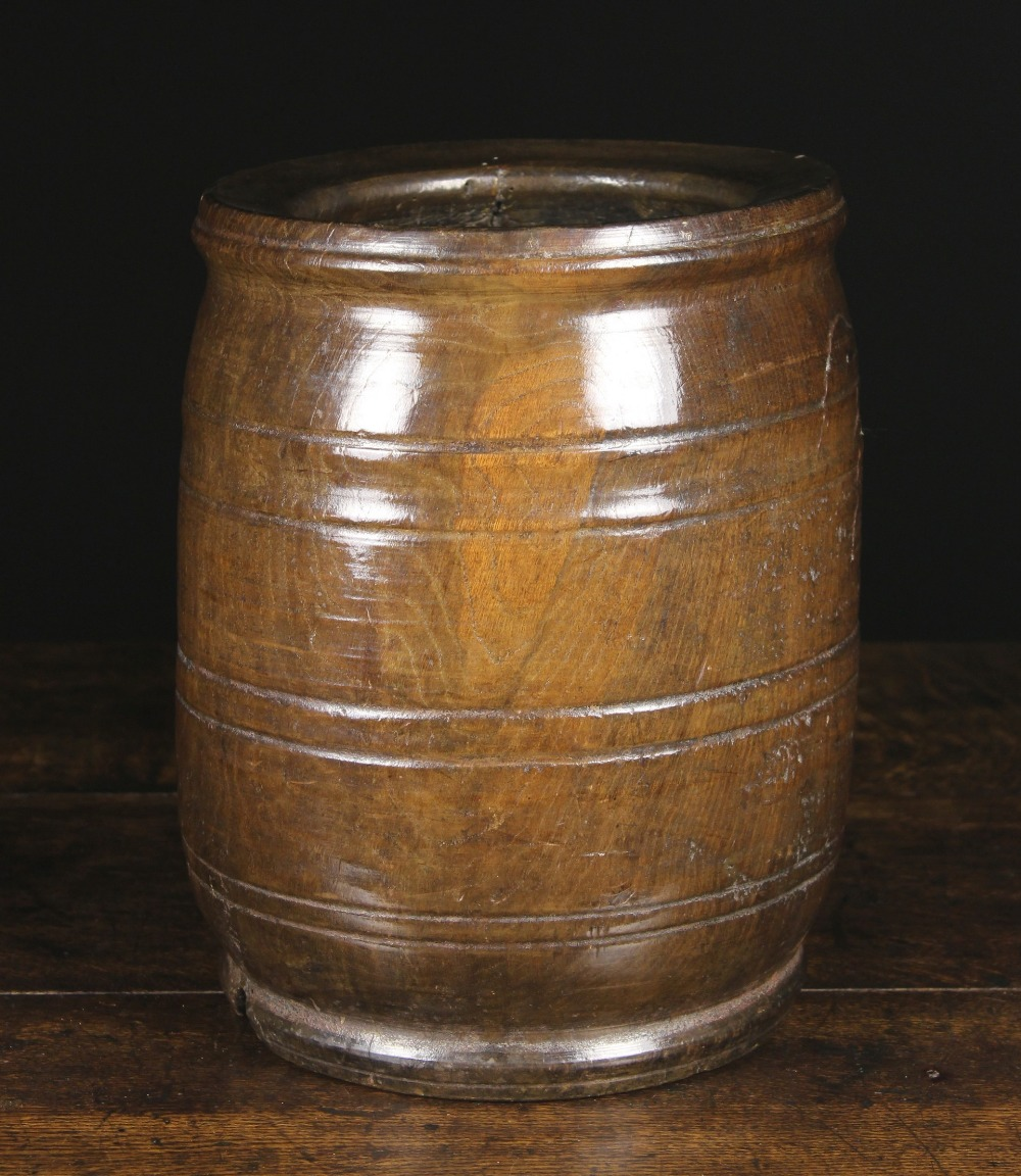 Lot 17 - A Fabulous 17th Century Turned Walnut Mortar of impressive proportions.