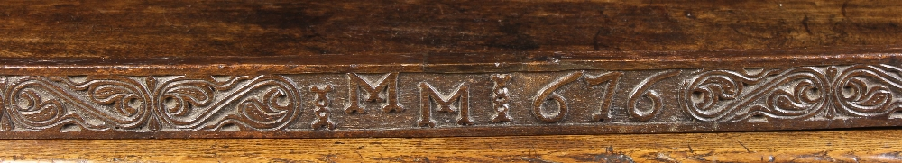 Lot 4 - A Long 17th Century Carved Oak Rail decorated with a band of foliate S-scrolls with strap-work