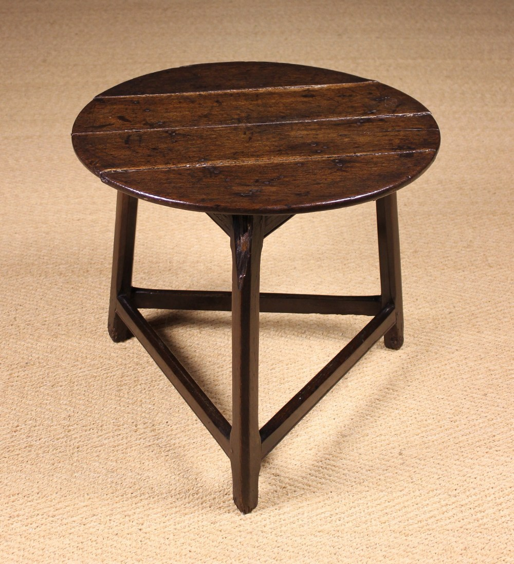 Lot 54 - An 18th Century English Oak Cricket Table.