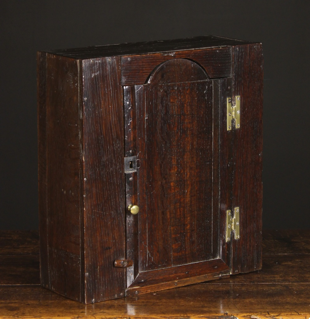 Lot 38 - A Small 18th Century Boarded Oak Wall Cabinet of good colour and patination.
