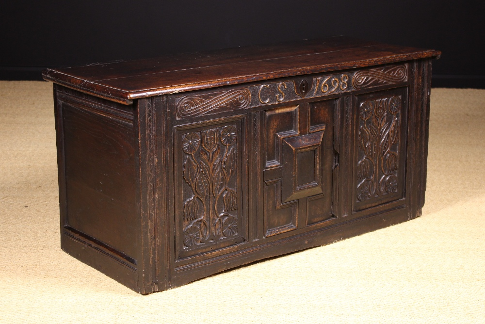 Lot 5 - A Late 17th Century Carved Oak Coffer.