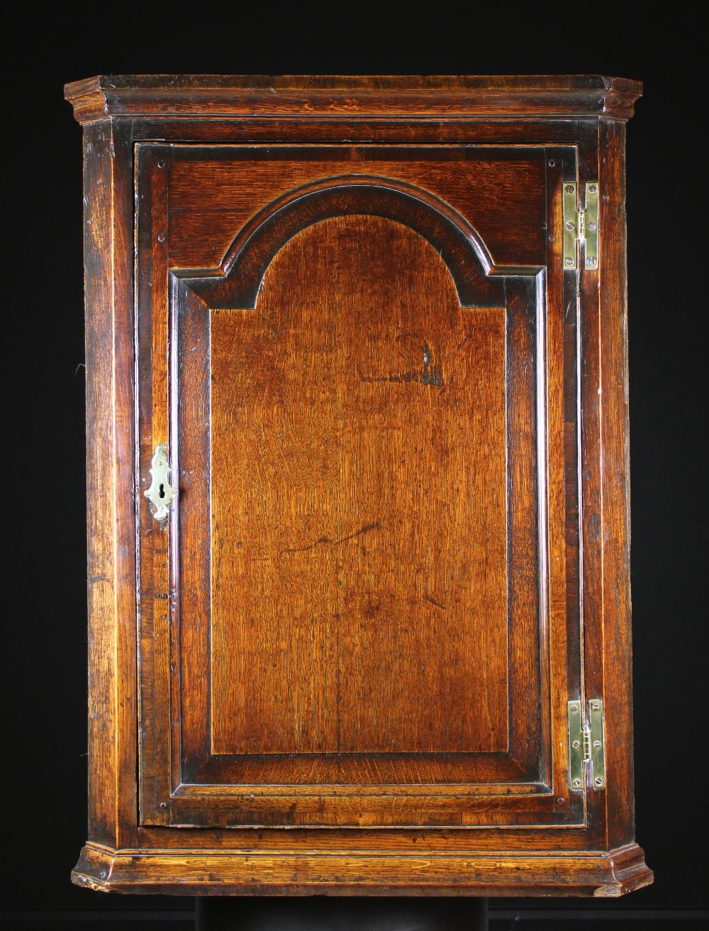 Lot 50 - A George III Oak & Mahogany Cross-banded Hanging Corner Cupboard of fine colour and patination.