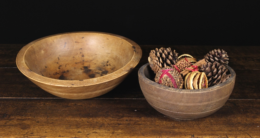 Lot 27 - Two 19th Century Turned Treen Bowls; one 4 ins (10 cm) high, 9½ ins (24 cm) in diameter,