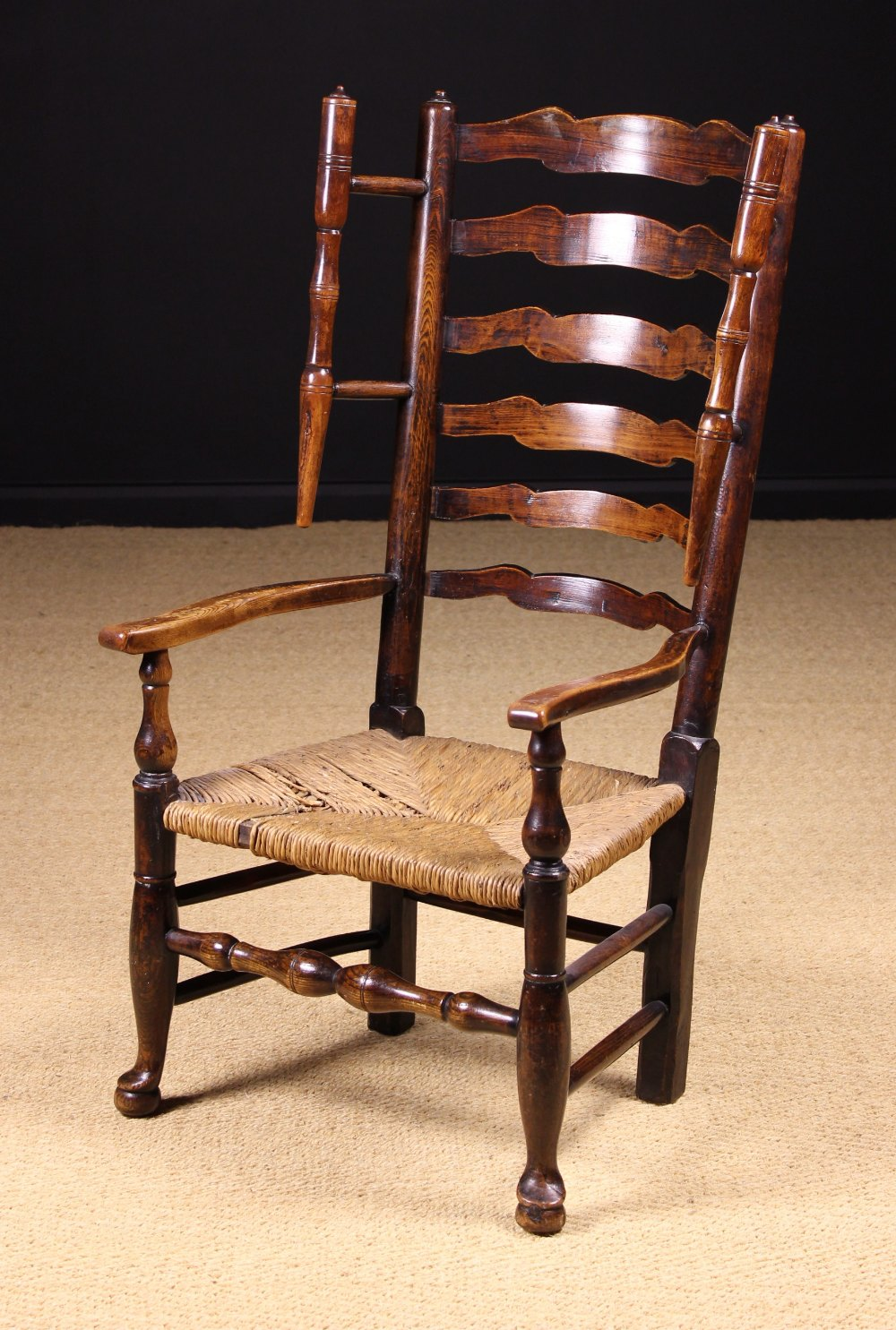 Lot 53 - A Fine Late 18th/Early 19th Century Lancashire Wavy Ladder-back Winged Armchair with rush seat.